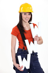 Woman construction worker holding WWW letters