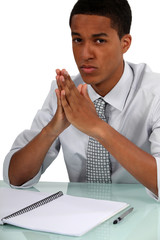 young Afro-American businessman posing