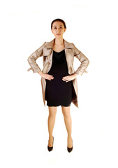 Asian woman in coat.