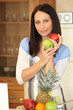Woman with fruit in a kitchen