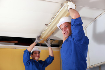 electricians installing neon