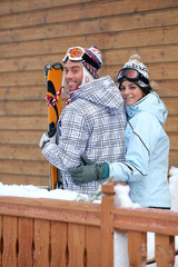 Young couple of skiers