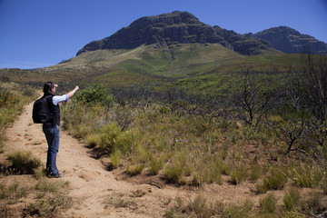 A man walikng up a mountain