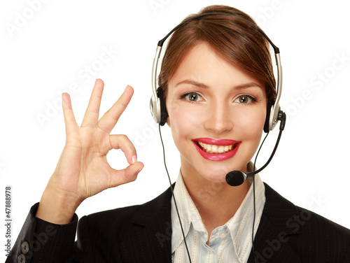 A smiling customer service girl showing ok