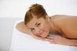 Smiling woman lying on a massage table