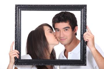 Girl tenderly kissing a man