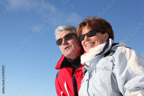Retired couple in skiwear