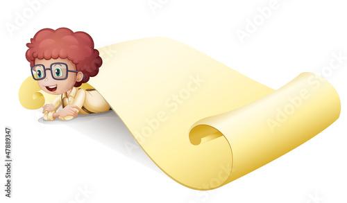 A boy under a paper sheet