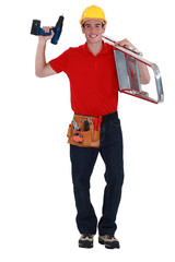 Handyman carrying ladder to next job