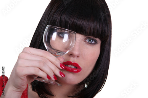 woman holding empty glass
