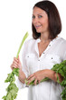 woman holding fresh parsley leaves
