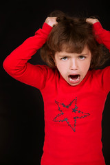 little girl shouting with arms to head