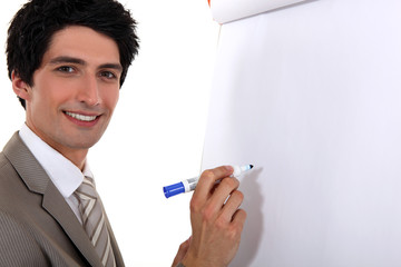 Man writing on flip chart