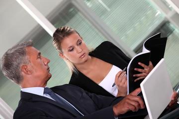 Boss and secretary interacting
