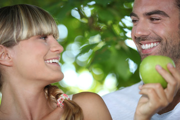 Couple with apple in hand