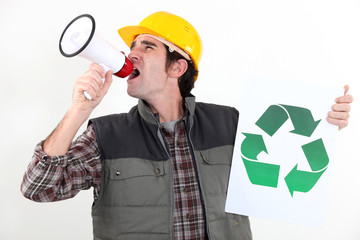 craftsman holding a recycling label and speaking megaphone