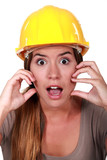A horrified female construction worker.