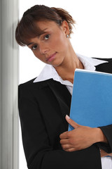 Brunette holding folder