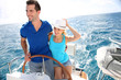 Young couple navigating on a yacht in caribbean sea