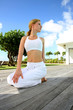 Woman doing stretching exercises outside the gym