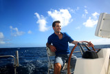 Smiling young sailor navigating in Caribbean sea
