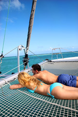 Young couple relaxing at the front of yacht