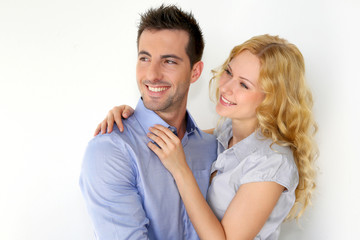 Portrait of cheerful couple on white background