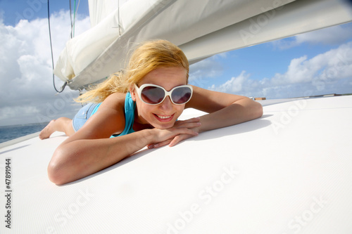 Young woman with sunglasses relaxing on yacht