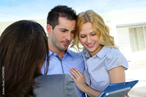 Young couple visiting luxury house for vacation