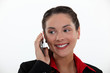 Attractive businesswoman talking on her mobile phone