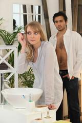 Couple preparing in the bathroom