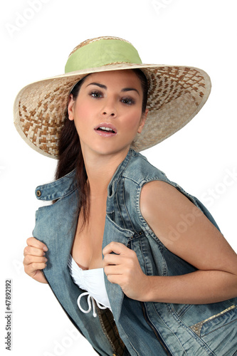 Flirtatious brunette wearing hat