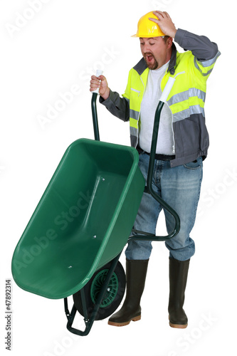 Man with a wheelbarrow having an accident