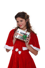 Mrs. Claus holding a Christmas present