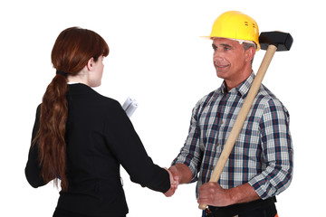Female architect greeting builder