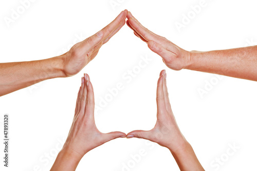 Hände bilden ein Haus