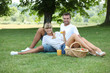 Young couple having a picnic in a meadow