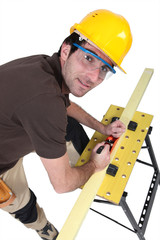 Woodworker using plane