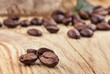Coffee grains on wooden background
