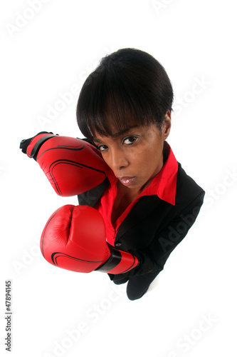 Angry woman with her punching gloves