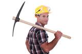 craftsman holding a pick on his shoulder