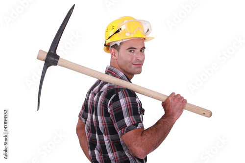 craftsman holding a pick on his shoulder