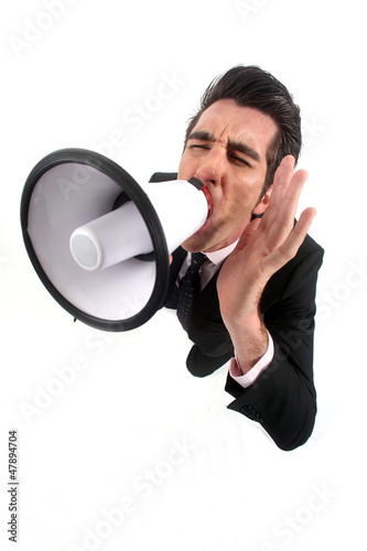 Businessman yelling into a megaphone