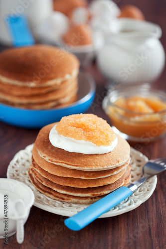 Buttermilk oat bran pancakes with pike caviar, selective focus