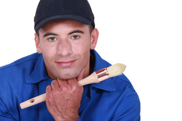 Man holding paint brush