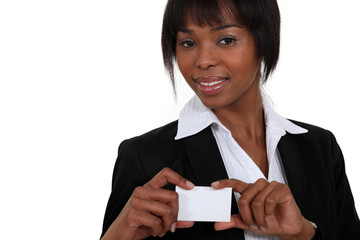 black businesswoman showing visit card