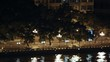 Cars go along embankment of Pearl river at night in light of