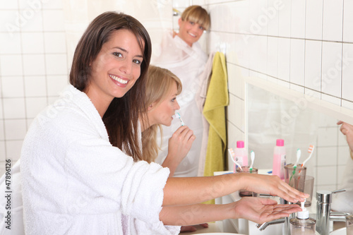 Young women getting ready for their day