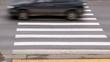 Cars quickly go on pedestrian crossing near sidewalk