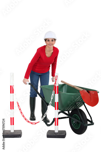 Woman construction worker on white background